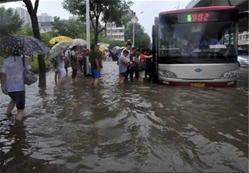 Dozens Dead as Floods, Typhoon Ravage China