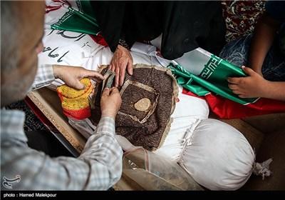 پیکر تازه تفحص شده شهید قدرت الله سرلک در حسینیه معراج شهدای تهران