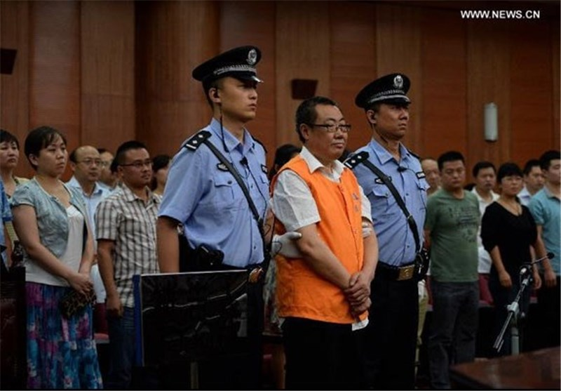 "China's ""Smiling"" Official Jailed 14 Years"
