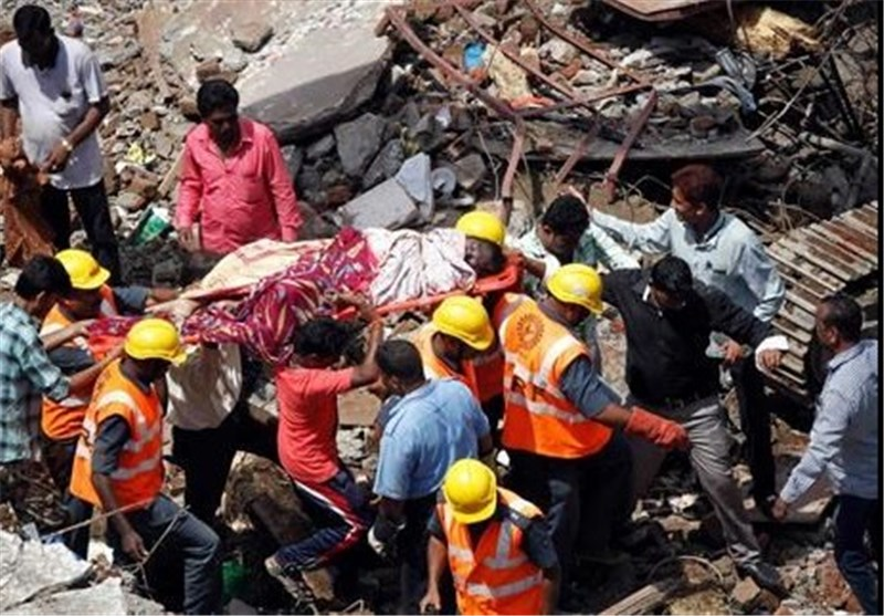 60 Dead in India Building Collapse