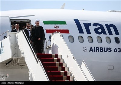 Photos: President Rouhani Returns Home
