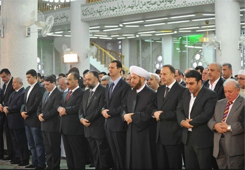 Syria's Assad Prays at Damascus Mosque for Eid Al-Adha