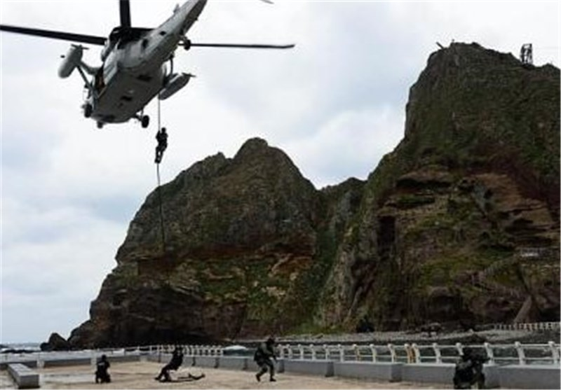 Japan Holds Military Drill as S. China Sea Islands Dispute Widens