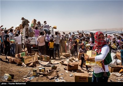 توزیع کمک های بشردوستانه از جمله چادر، پتو و مواد غذایی برای آوارگان سوری در عراق