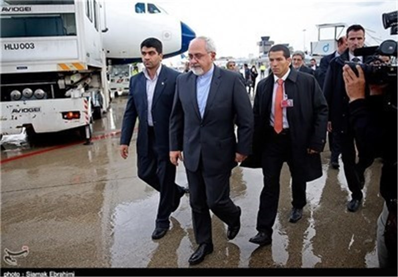 Iranian N. Negotiators Return Home from Geneva