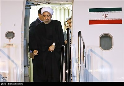 Photos: President Rouhani Arrives Back Home from Davos