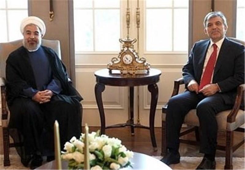 حسن روحاني و عبد الله غول