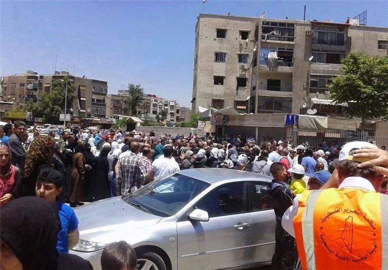 اتفاق تسویة ینهی معاناة الفلسطینیین فی مخیم الیرموک بریف دمشق
