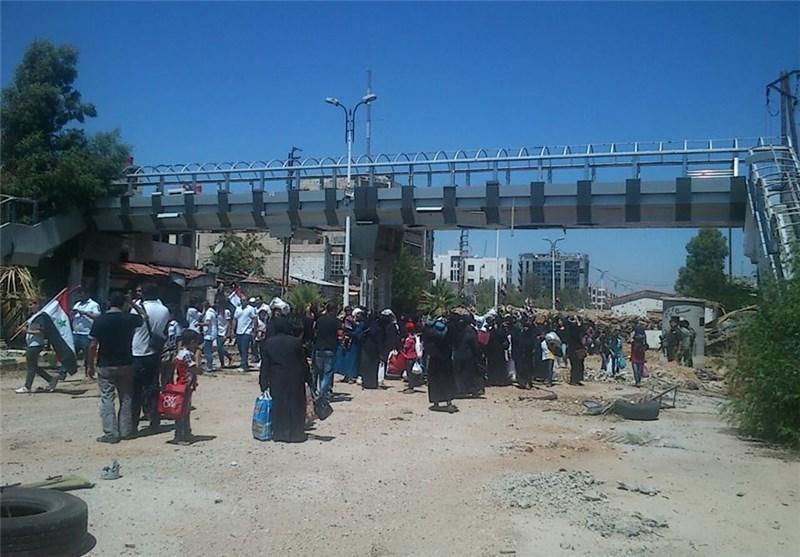 """أهالی """"حی القدم"""" جنوب دمشق یعودون إلى منازلهم استکمالاً للمصالحة + صور"""