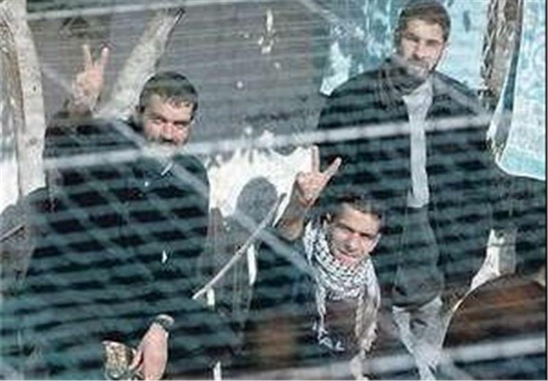 الاحتلال الصهیونی یحتجز 12 صحفیا فلسطینیا فی سجونه