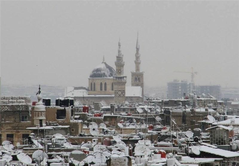 الثلوج تغطی شوارع العاصمة السوریة دمشق + صور