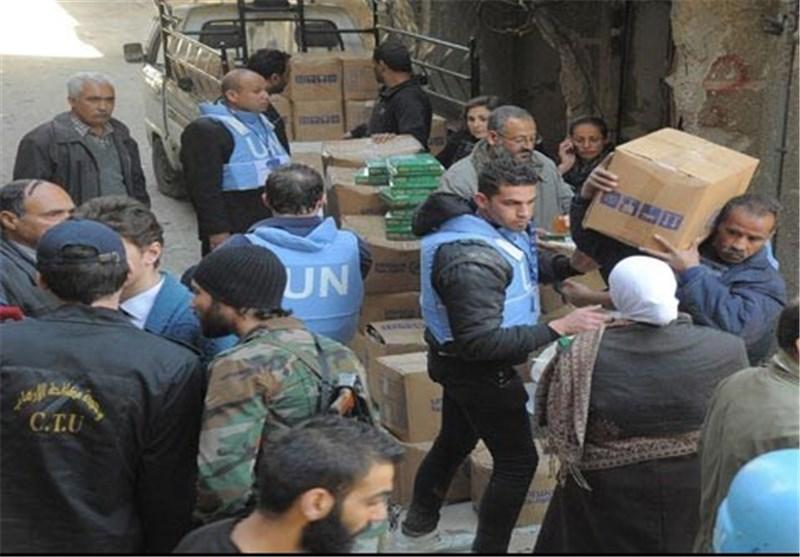 الإرهابیون یمنعون مخیم أهالی الیرموک جنوب دمشق من استلام المساعدات