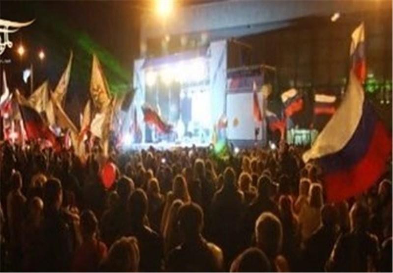 إحتفالات فی روسیا بمناسبة ضم «القرم» .. وبوتین یسخر من العقوبات الغربیة المفروضة على بلاده