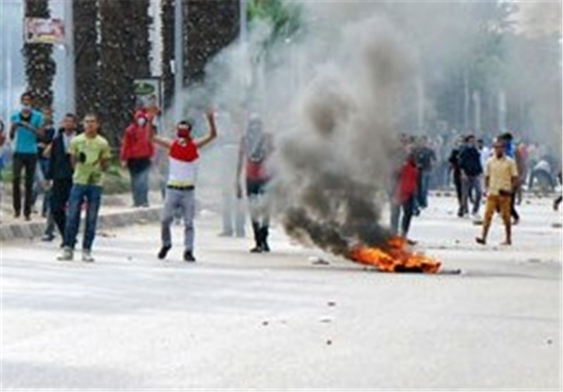 Egyptian Security Forces Fire Tear Gas at Pro-Mursi Supporters