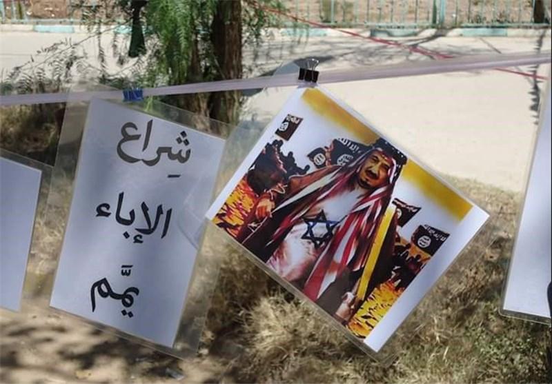بالصور.. معرض شراع الإباء یصور جرائم آل سعود ضد الشعب الیمنی