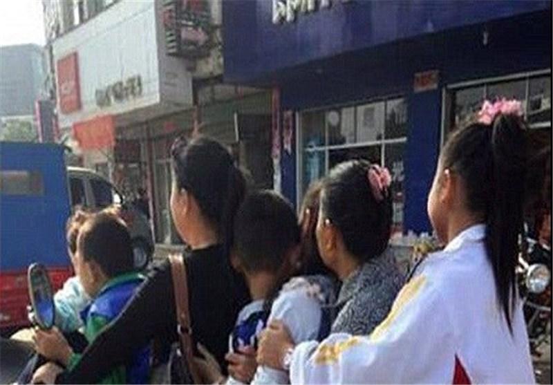 خانواده هفت نفره چینی سوار بر یک موتورسیکلت+ عکس