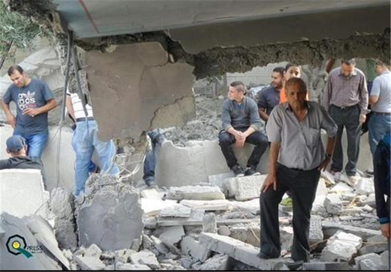 Palestinian Homes in East Al-Quds Razed by Zionist Regime