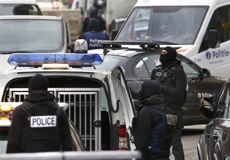 Eight People Held in Belgium after Anti-Terror Raids
