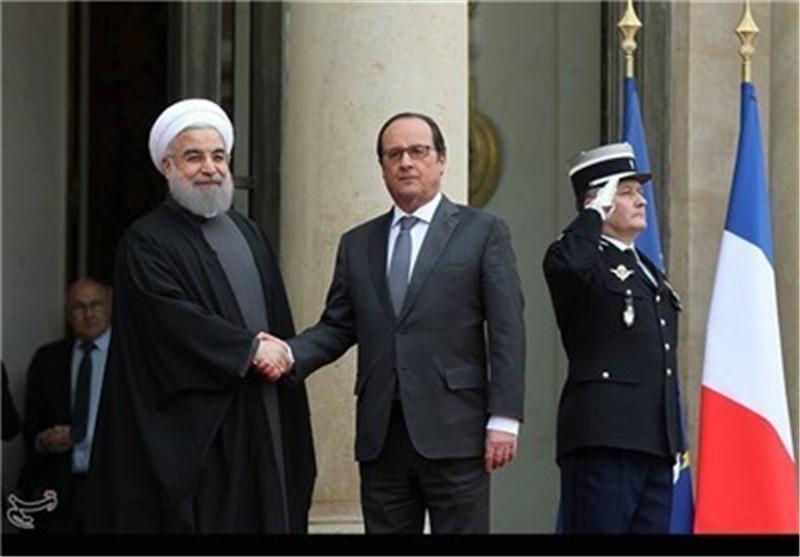 تأکید الرئیسین روحانی وهولاند علی فتح صفحة جدیدة فی العلاقات بین طهران وباریس
