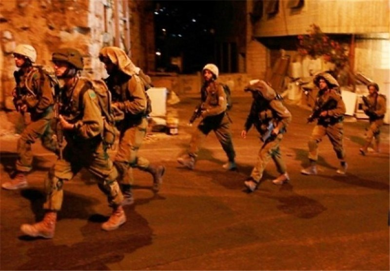 قوات الاحتلال الصهیونی تحول حی العیسویة الى ثکنة عسکریة وسط اعتقالات غیر مسبوقة