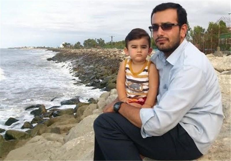 بوسهی غم انگیز کودک دو ساله شهید مدافع حرم بر چهره پدر + فیلم