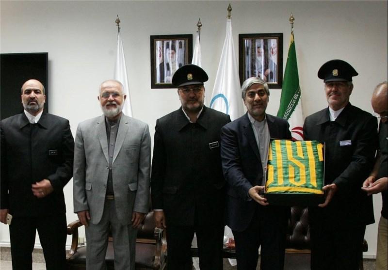هاشمی: پرچم امام رضا (ع) را به ریو میفرستیم تا به ورزشکاران روحیه بدهد + عکس