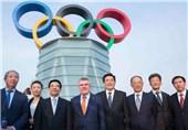 نصب حلقههای المپیک روی برج 250 متری پکن