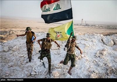 مقاتلو کتائب حزب الله في خطوط القتال بمکحول