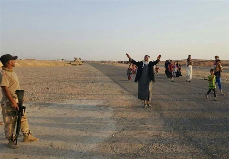 بالصور..نزوح 200 عائلة من الشرقاط قرب الموصل