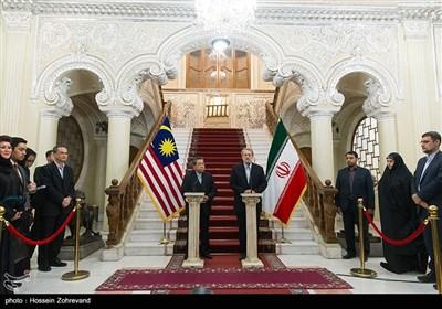 علی لاریجانی رئیس مجلس شورای اسلامی و امین حاج مولیا رئیس مجلس نمایندگان مالزی