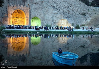 Visitors Tour Taq-Bostan Historical Site in Western Iran
