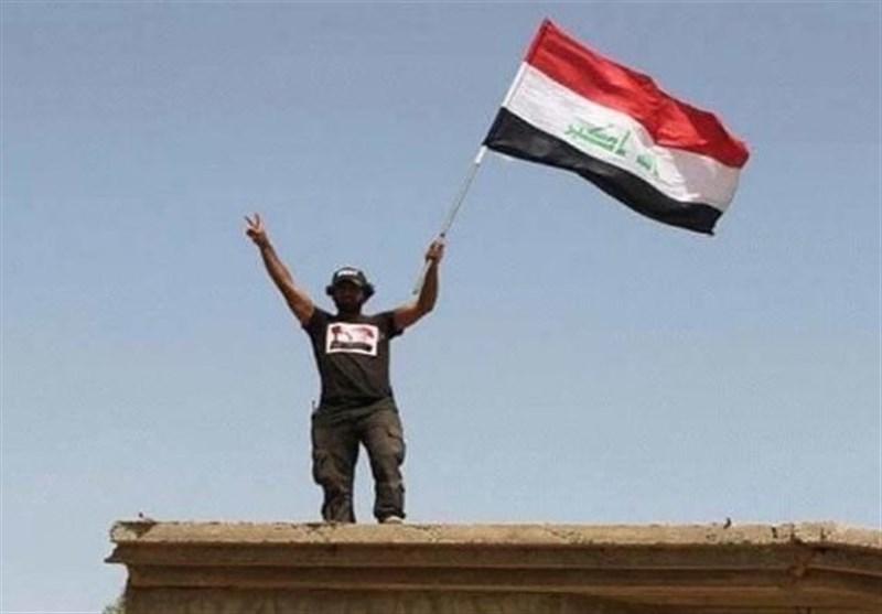 الحشد الشعبی یرفع العلم العراقی على مطار تلعفر