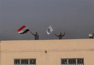 رفع العلم العراقی فی قریة نایف بالموصل