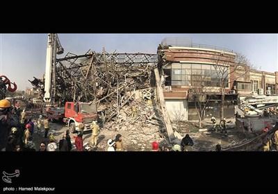 خبرگزاري تسنيم - فرو ريختن ساختمان پلاسکو در پي آتش سوزي - ?