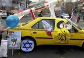 مردم ماکت موشکهای ایرانی را به راهپیمایی 22 بهمن آوردند+ تصویر