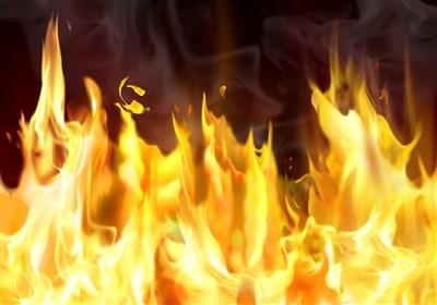 آتش گرفتن پژو 405 در جاده خاوران + عکس