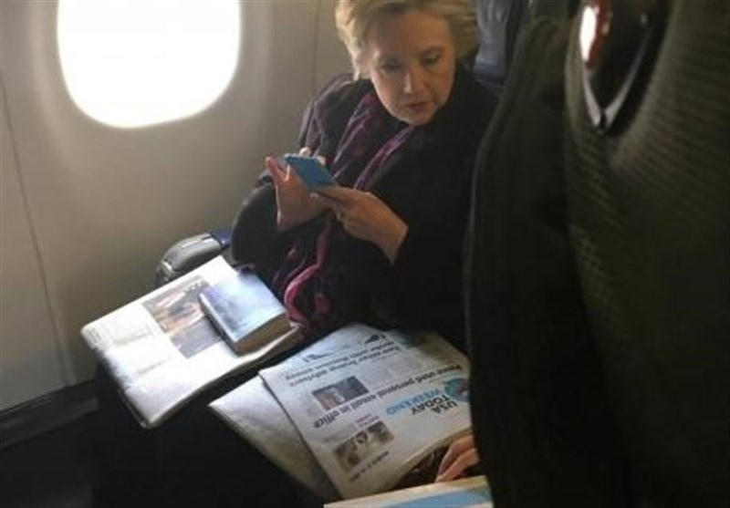 Snap of Clinton Reading Pence Email Headline Goes Viral