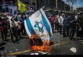 هاآرتص: پرچم و آدمک رهبران اسرائیل در تظاهرات تهران به آتش کشیده شد