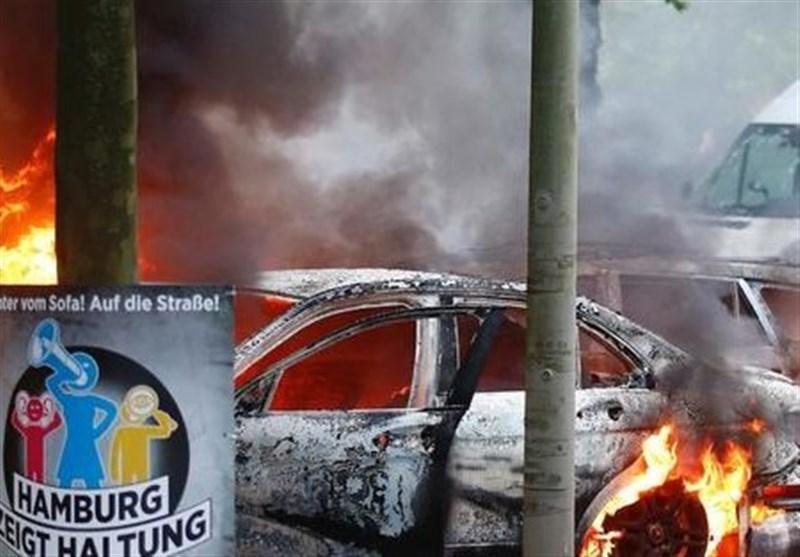 خودروهای در حال سوختن و تداوم ناآرامیها چند ساعت مانده تا آغاز نشست هامبورگ+تصاویر