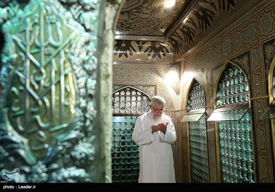 Leader Performs Dust Clearing Rite at Imam Reza's (AS) Shrine
