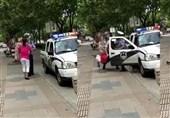 رفتار وحشیانه پلیس چین با مادر و نوزاد+فیلم و عکس