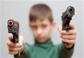 child playing with gun