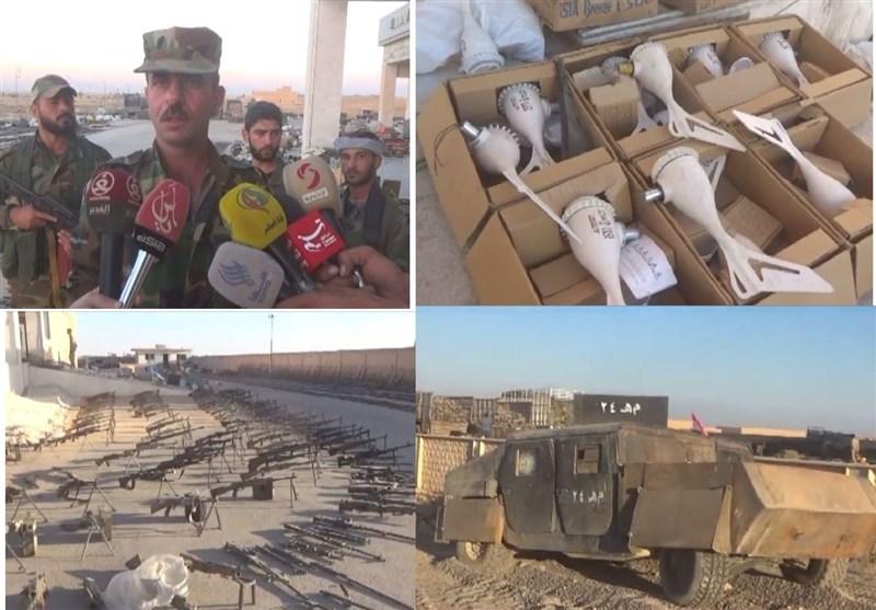 أسلحة مخیفة لتنظیم داعش یعثر علیها الجیش السوری فی مدینة المیادین بعد تطهیرها +فیدیو وصور
