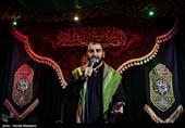 روضه خوانی فرزند شهید مدافع حرم بر سر پیکر پدر +فیلم