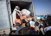 تخلیه بار کمک های مردمی توسط روحانیون حوزه علمیه + تصاویر