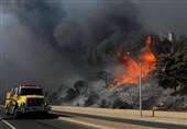 Winds Churn Unrelenting California Wildfire