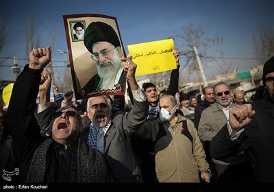 People Rally in Tehran to Condemn Riots