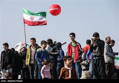People in Iran's Capital Participate in Revolution Anniversary Rallies