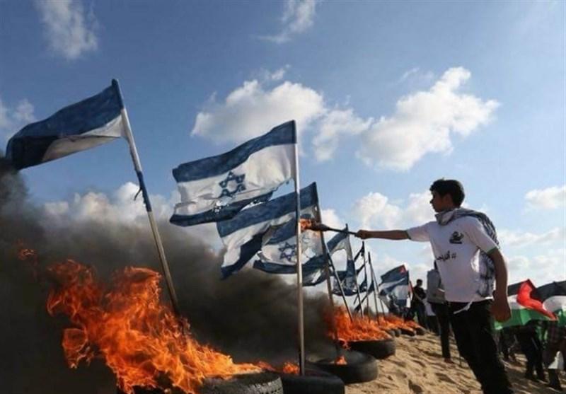 """جمعة """"حرق العلم الصهیونی """" .. الالاف یشارکون وعشرات الاصابات برصاص الاحتلال على حدود غزة"""