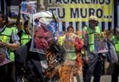 Migrants in Mexico Stage Colorful Anti-Trump Protest